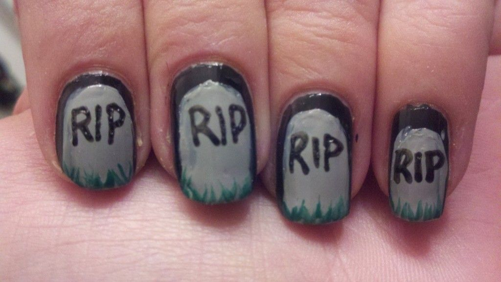 This is the simplest Halloween nail art you could try. Just draw a gravestone in gray polish over black base with 'RIP' written over it in black.
