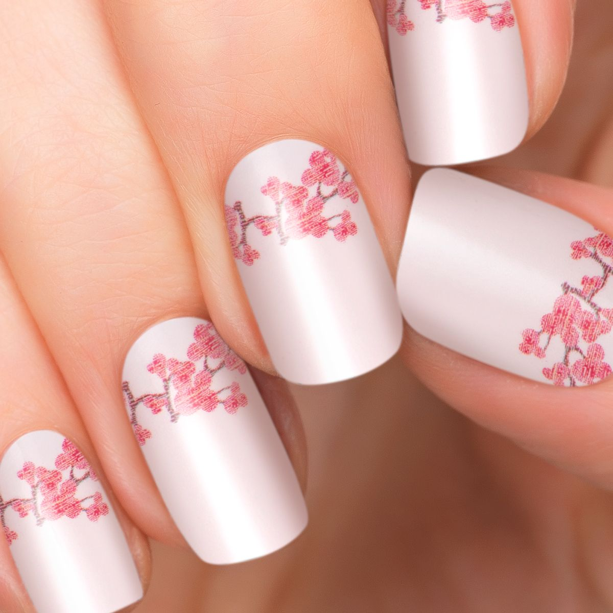 1 manicure set includes: 2 sheets of 8 double-ended nail appliqués ...