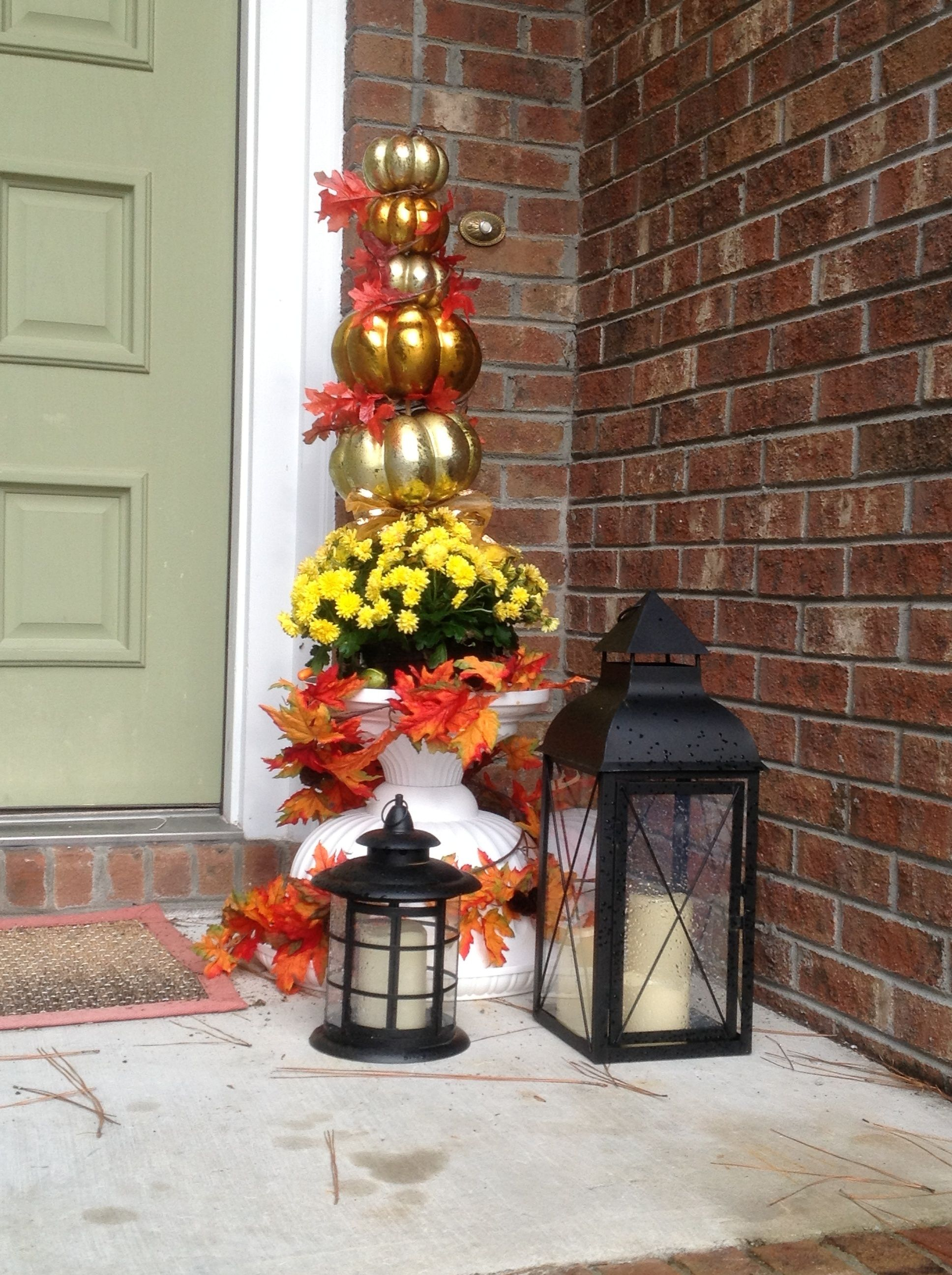 Thanksgiving fall topiary - made with Michael's after Halloween clearance decor. Think creatively when it comes to outdoor urns; this one is topsy turvy!