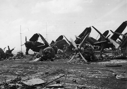 The wreckage of burnt aircraft on the flight deck the aircraft carrier USS Bunker Hill, which was hit by two Japanese kamikaze planes in less than a minute, off the coast of Japan on May 11,1945. The attack killed 392 and wounded 264. My uncle survived this attack.