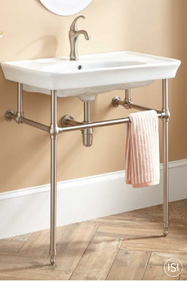 Want To Create The Illusion Of More Space In Your Powder Room Or