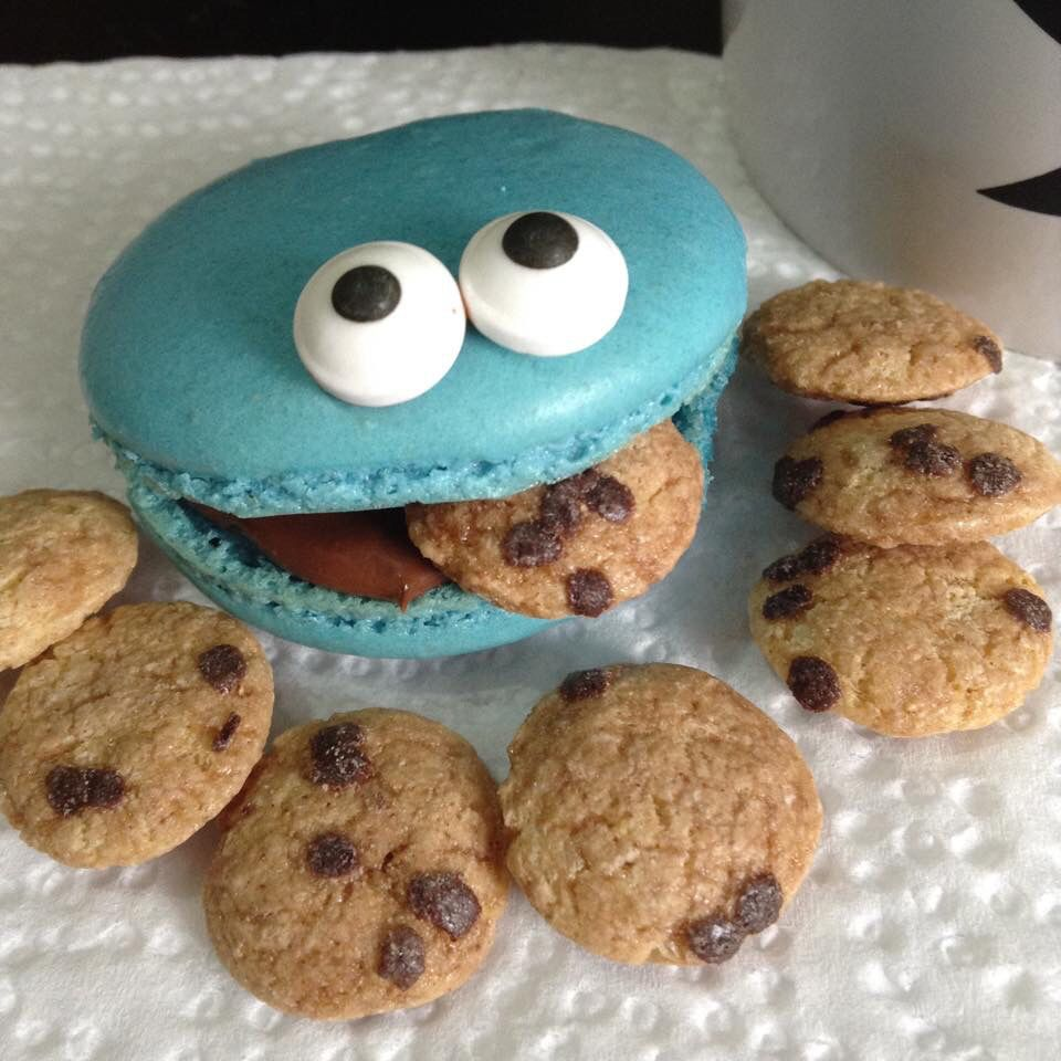 Cookie Monster macarons. Cookie is vanilla flavored and filling is chocolate ganache. 'Cookies' are Cookie Crisp cereal.