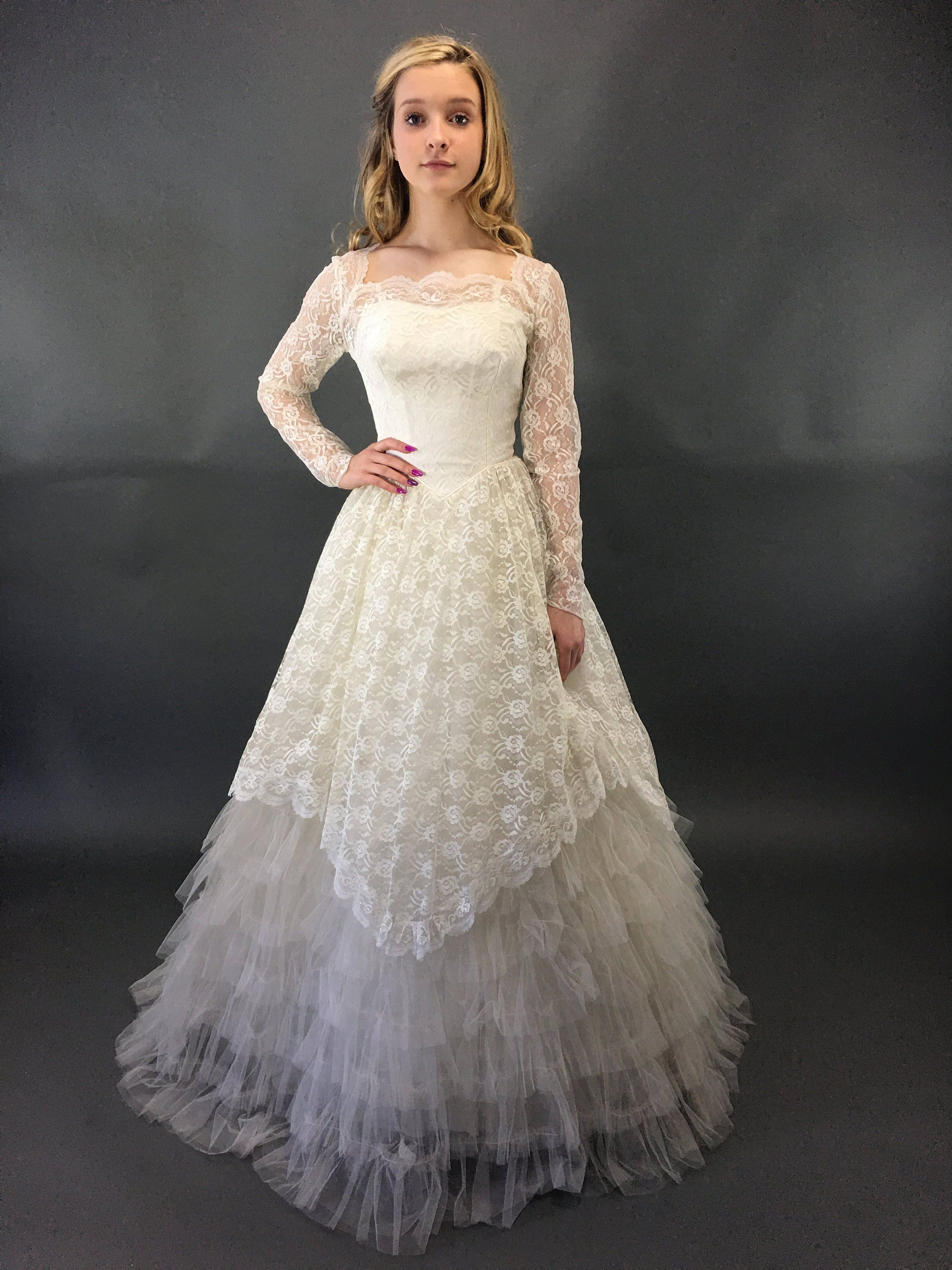 long sleeve tulle ball gown wedding dress