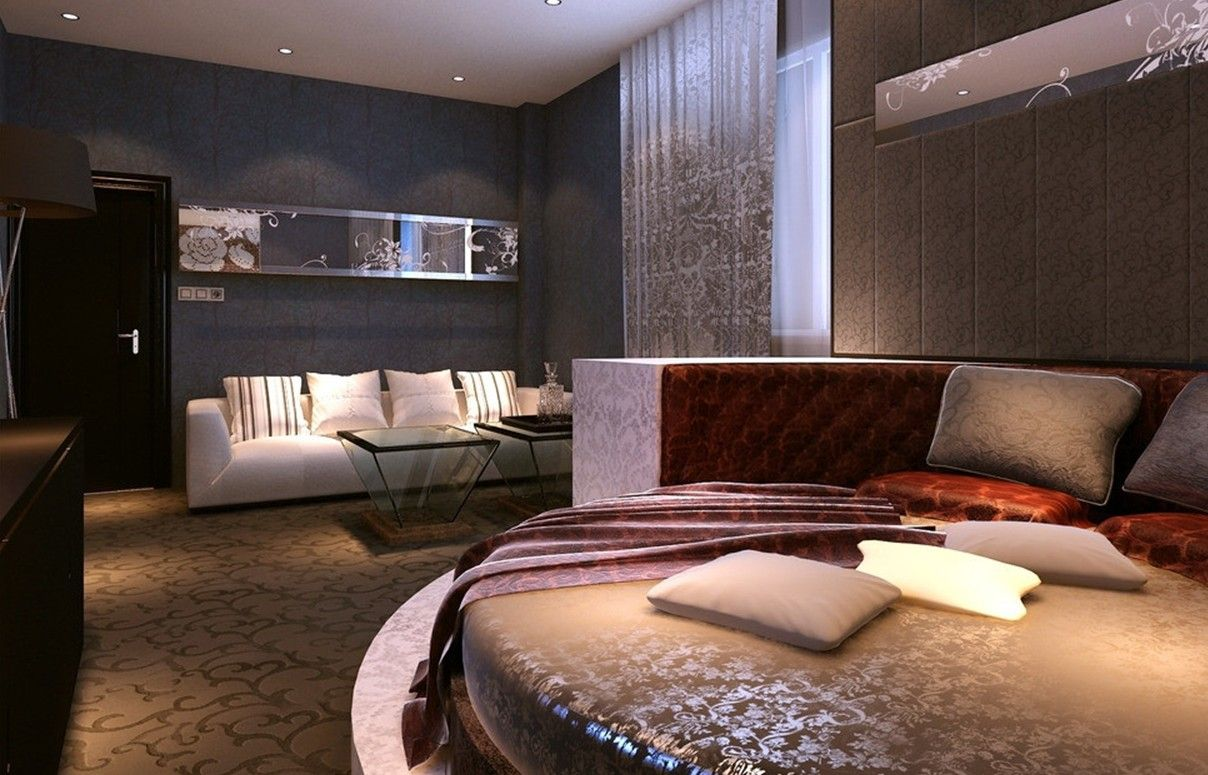 Endearing Bedroom Inspire With Cream Carpet Flooring Idea And Round Shaped Bed Also Brown Tufted