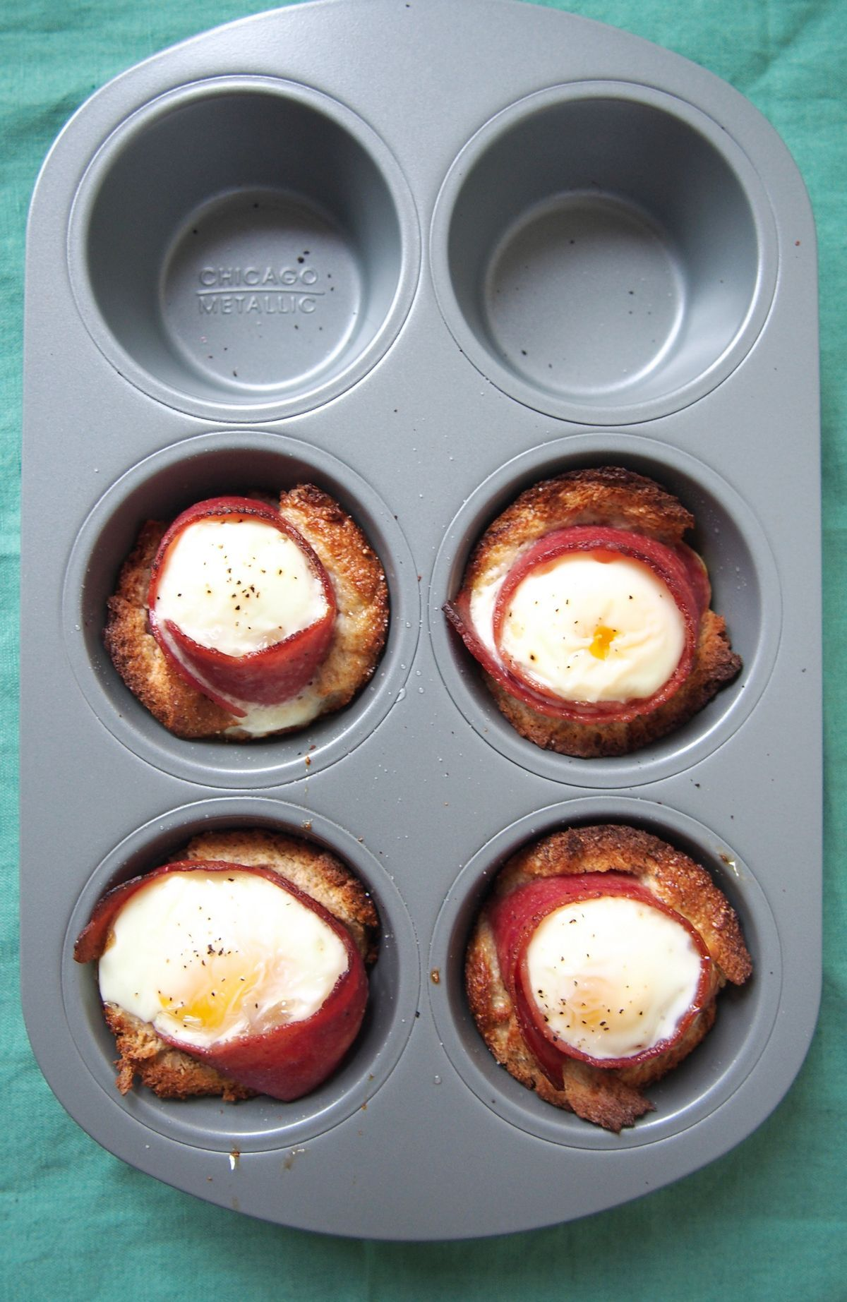 All you need is a muffin tin, and bacon, and eggs, and bread, and everything you love, to make this