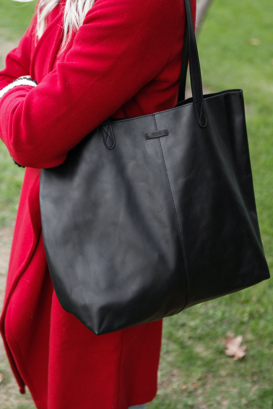 a1c97761337 TOMS Matte Black Leather Cosmopolitan Tote. This tote bag is a great option  for work and school.