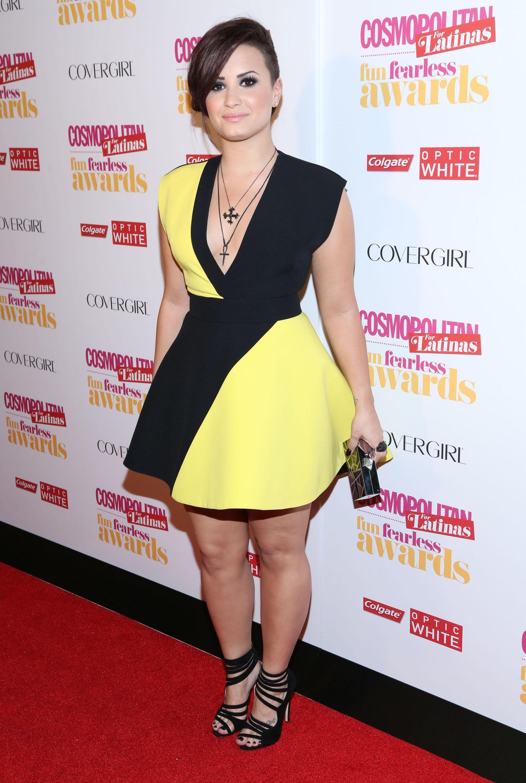 Demi Lovato Wearing A Dark Yellow Dress - http://imashon.com/w ...