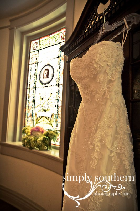 Wedding dress, bridal gown with stained glass window and bouquet ...