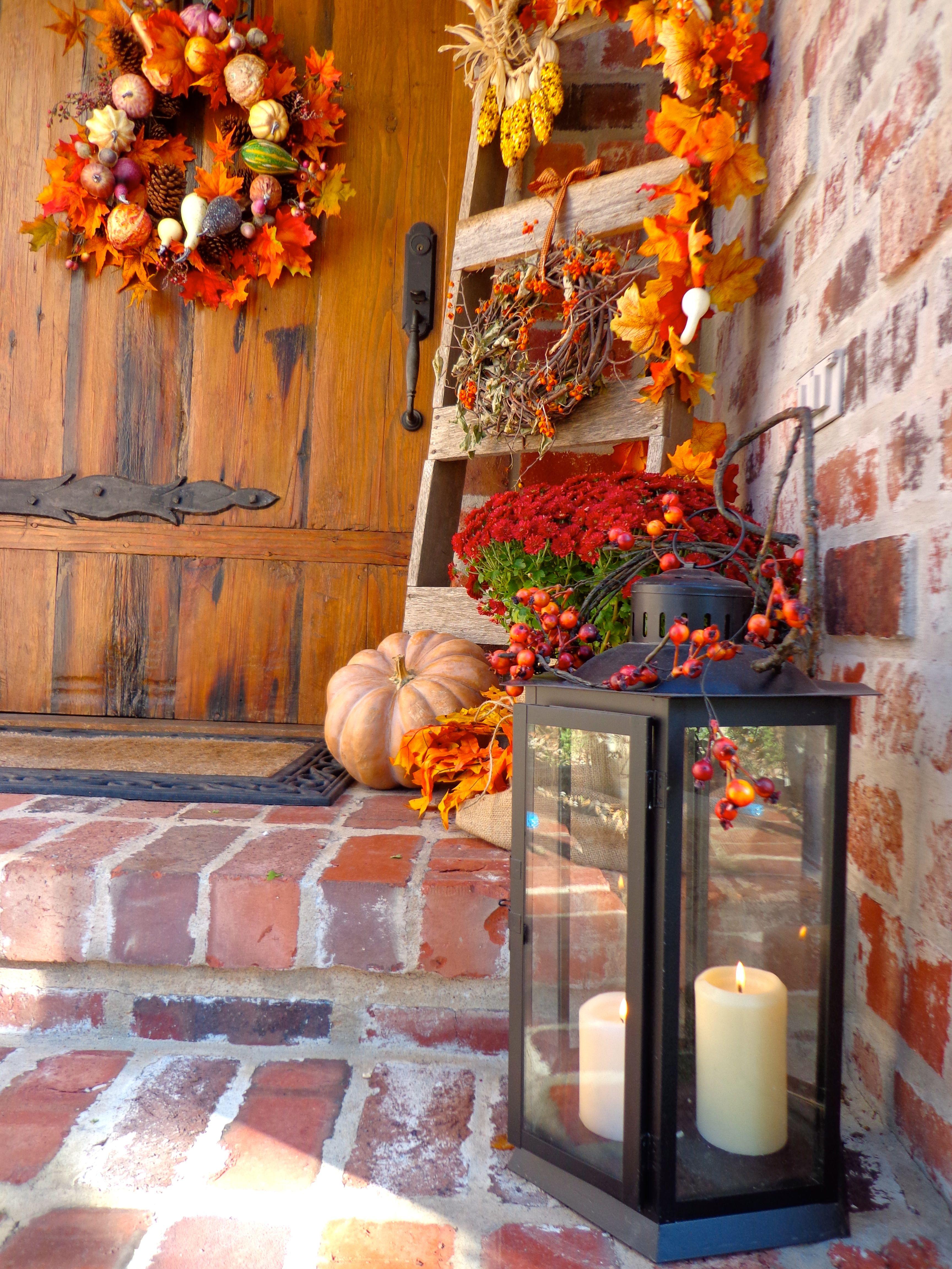 Fall front porch ladder w corn fourseasons pinterest