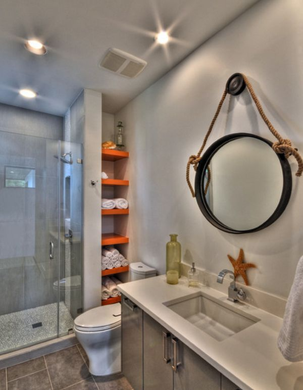 Ways To Creatively Add Storage To Your Bathroom Round Mirrors - Rolled towel storage for small bathroom ideas