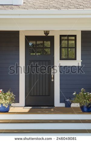 Closed Black Front Door with White Surrounding Door Frame and Blue ...