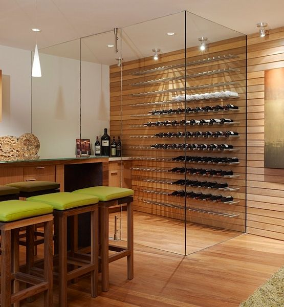 Pale shades of green coupled with mid-tone shades of wood keep the wine-tasting atmosphere Zen and relaxed.