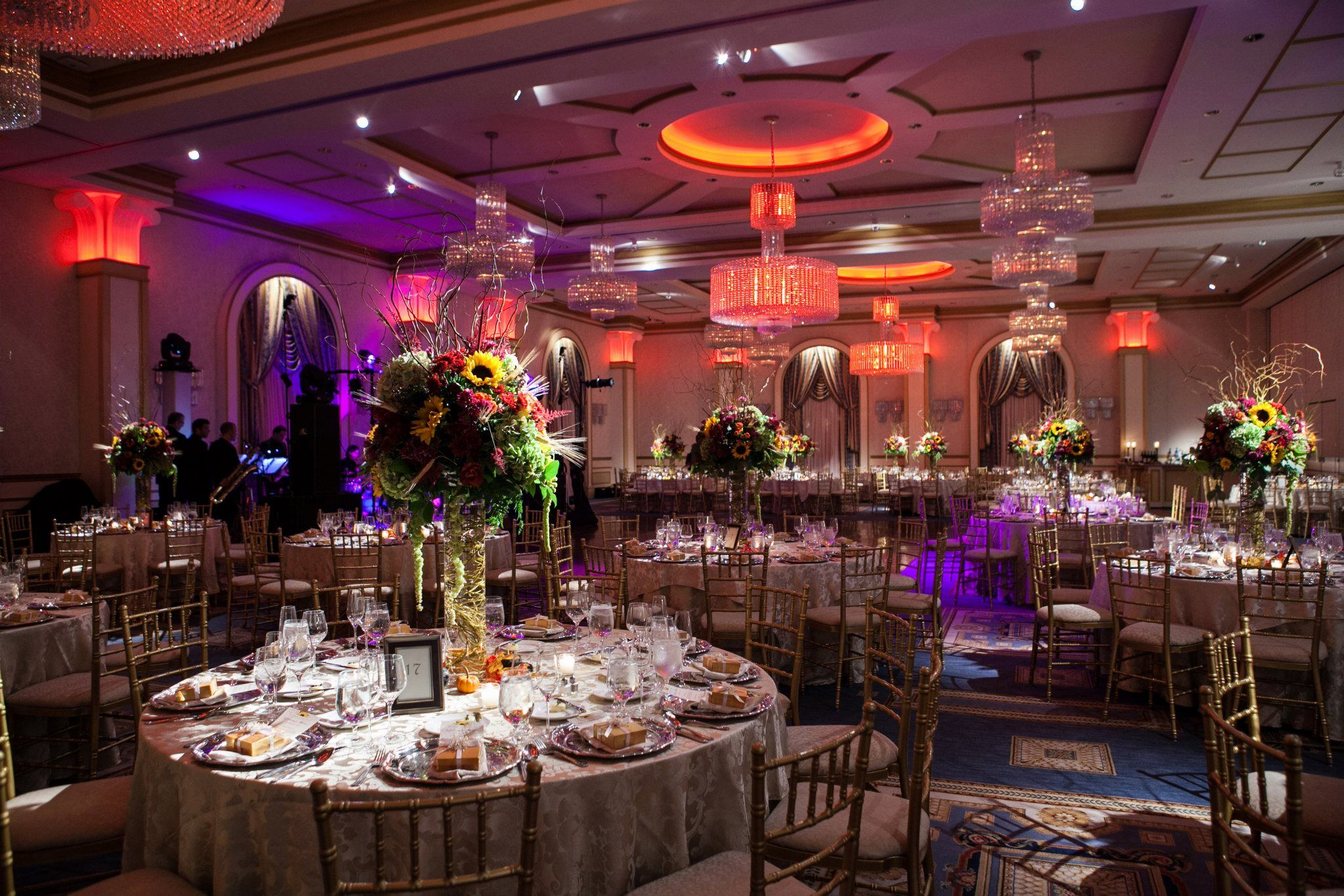 the grand ballroom with different led lighting colors at a luxury wedding venue the grove