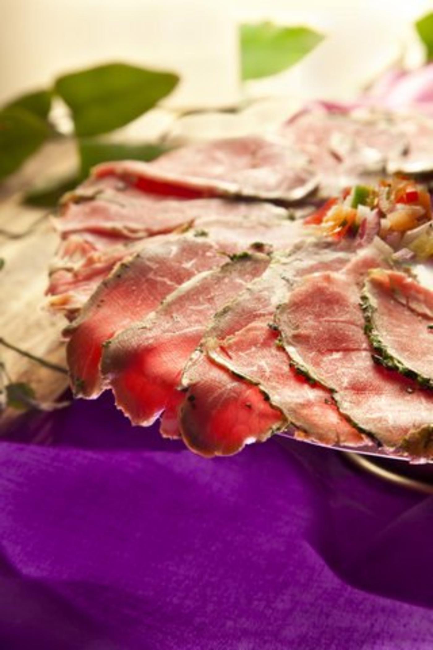 Beef Carpaccio with Tomato Vinaigrette.