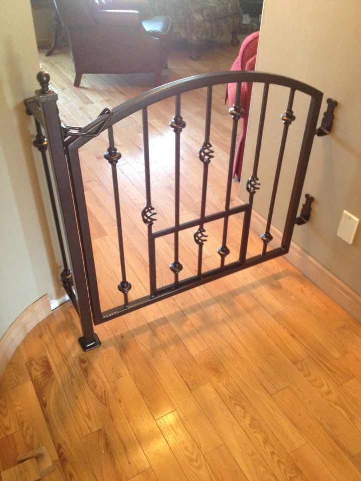 Elegant Arched Gate With Smaller Dog Gate Within The Main
