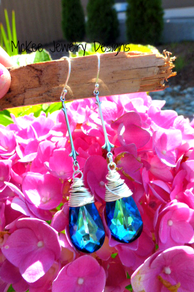 Art deco drops, antiqued sterling silver wire wrapped and blue crystal earrings. McKee Jewelry Designs