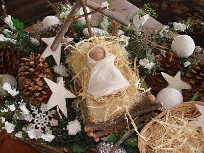 Sweet Baby Jesus laying in a manger. Here He is, sleeping peacefully on a soft bed of straw. Wrapped so cozy in His swaddling clothes. His cradle bears a cross above His head which points to heaven…reminding us why He came.