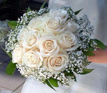 Hand Tied Bouquet Of White Roses Rimmed With Babies Breath And Ruscus Foliage Flower Bouquet Wedding Bridesmaid Flowers White Wedding Bouquets