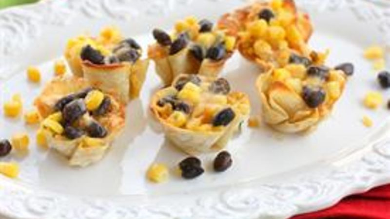 Layers of rice, beans, corn, chicken, and cheese layered in a wonton wrapper and baked until crispy.