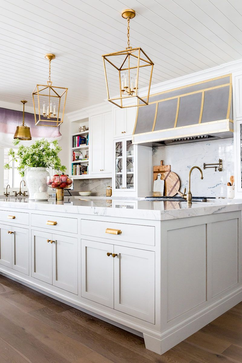 White Grey And Gold Kitchen/ Shape Of Feet On Island, Brass Hardware. Knobs  Not Cup Pulls