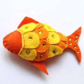 For the Pisces in me . . .       Follow the link to claim a free template for this shimmer fish and get stitching!