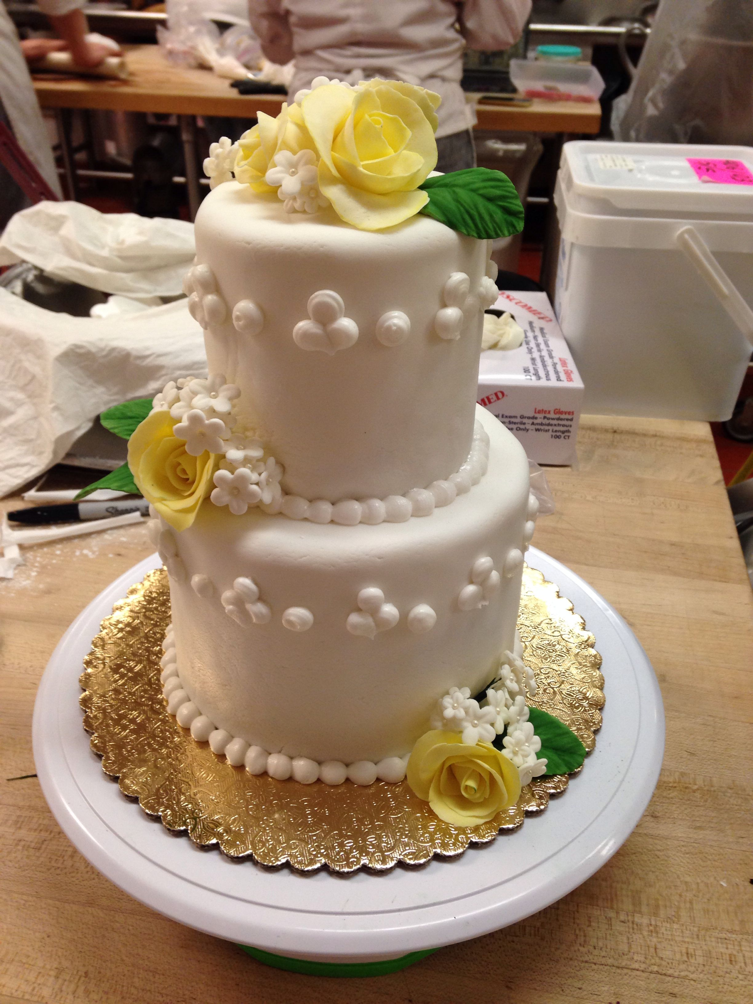 High-ratio chocolate cakes filled with Italian buttercream covered in fondant
