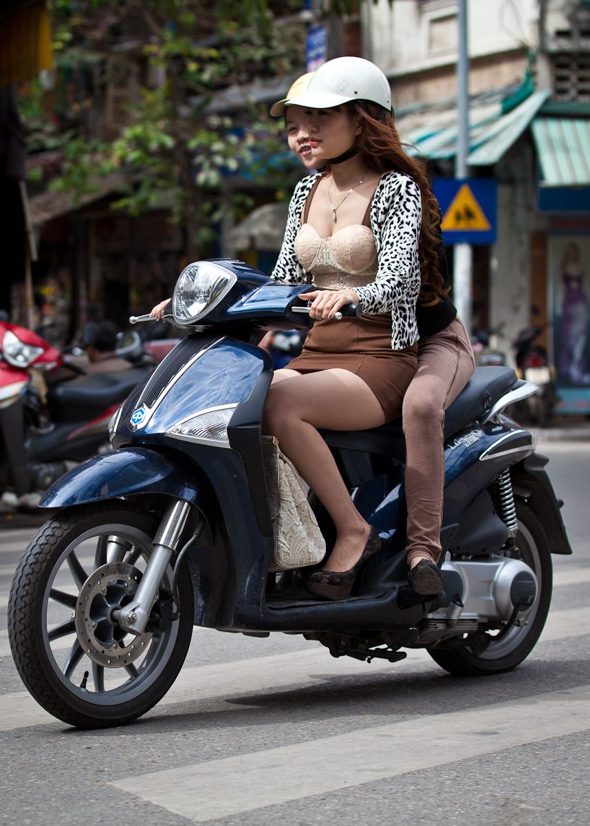 Naked asian girl on scooter