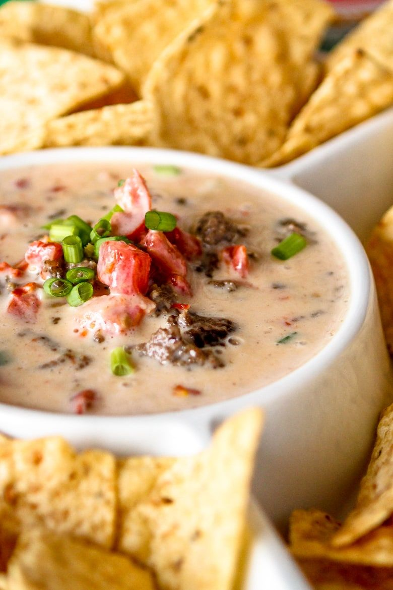 The Addition Of Browned Ground Beef In This White Cheese Beef Queso Dip Really Stretches This Delicious Game With Images Queso Dip Recipes White Queso Dip White Cheese Dip