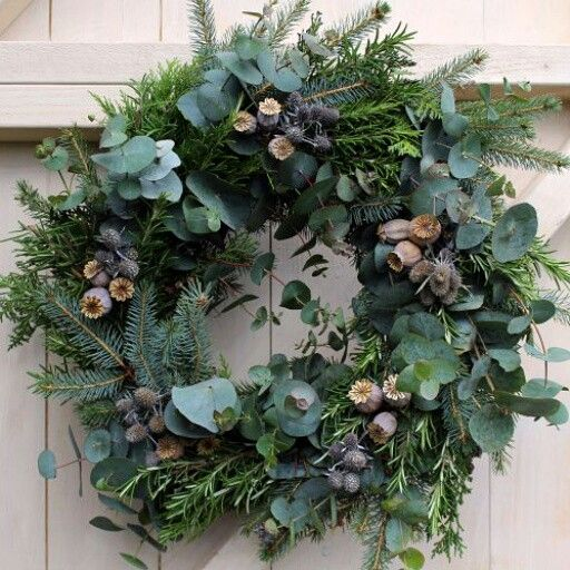 Photo of Foliage Christmas Wreath with poppy seed heads, sea holly and herbs.