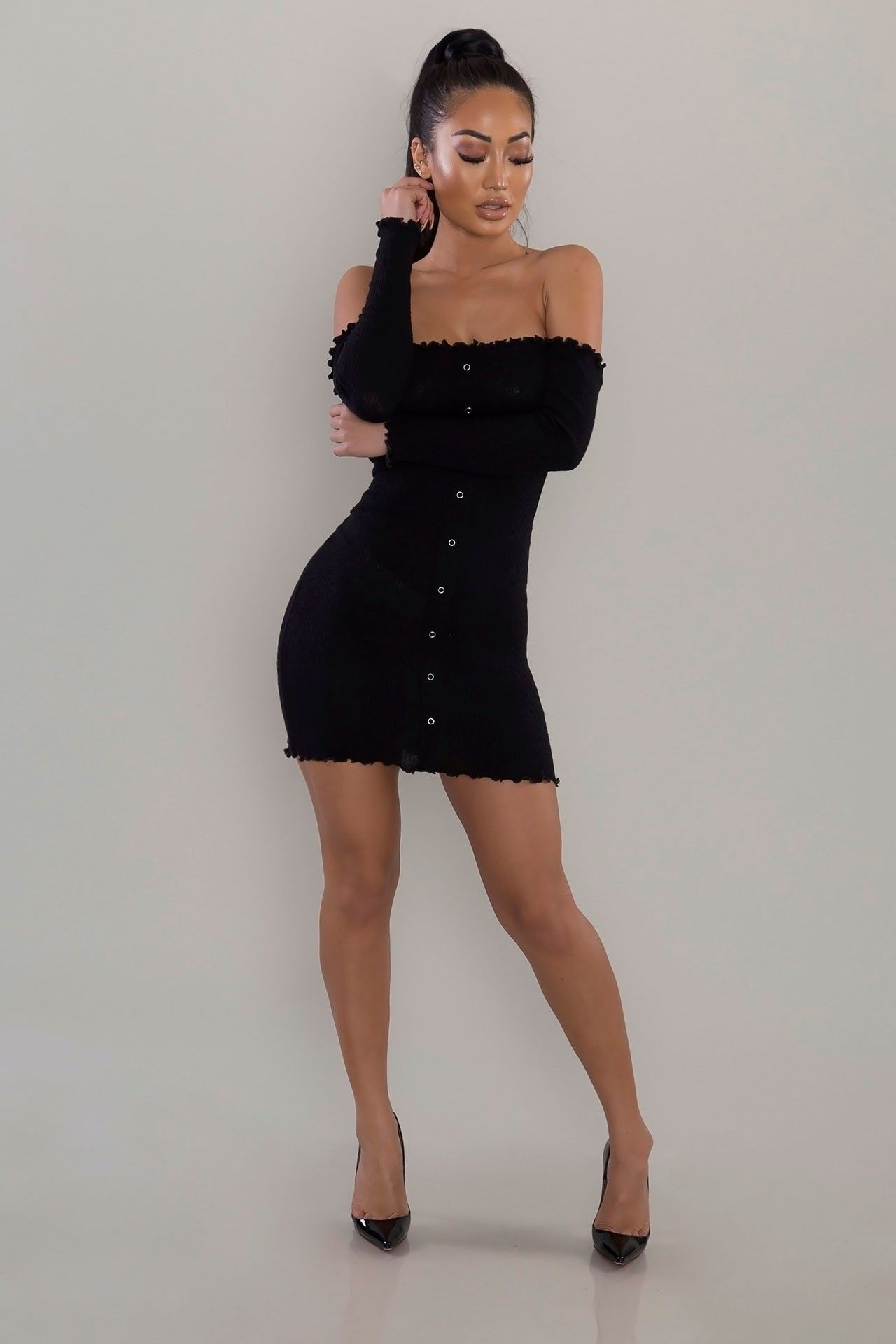 d548175b11a3 Cut from a ribbed knit that hugs every curve, this figure-flaunting mini  dress features an off-the-shoulder cut, long sleeves, and a faux button- front ...