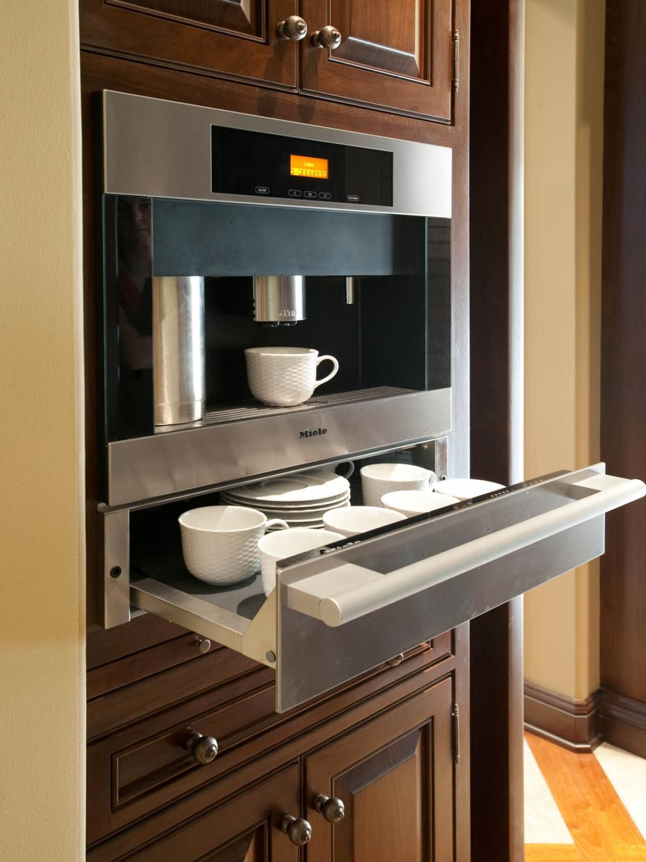 A Coffee Station Is Housed In Niche With A Custom Cabinet