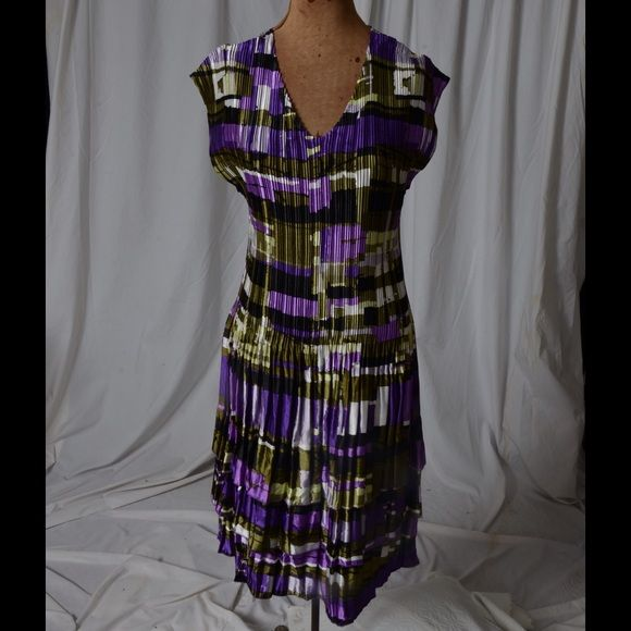 Purple print dress Purple, Green, Black, and White print dress.  Stretches to your size! Dresses
