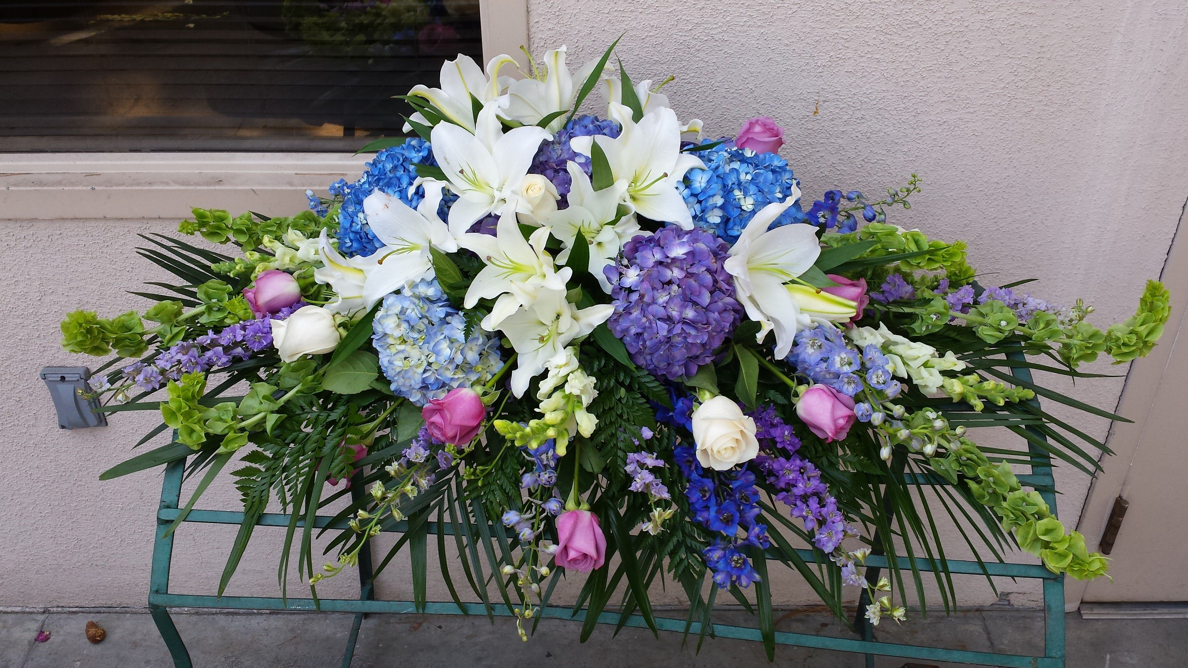Feeling blue casket spray flowers pinterest casket funeral send feeling blue casket spray in burbank ca from samuels florist the best florist in burbank all flowers are hand delivered and same day delivery may izmirmasajfo