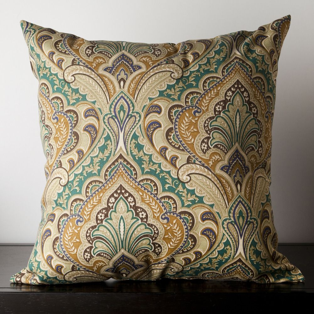 This lovely decorative pillow features a paisley design. Colors of teal, burgundy, caramel, taupe, and royal blue are eye catching. Add this outdoor pillow to your outdoor space for a touch of style.