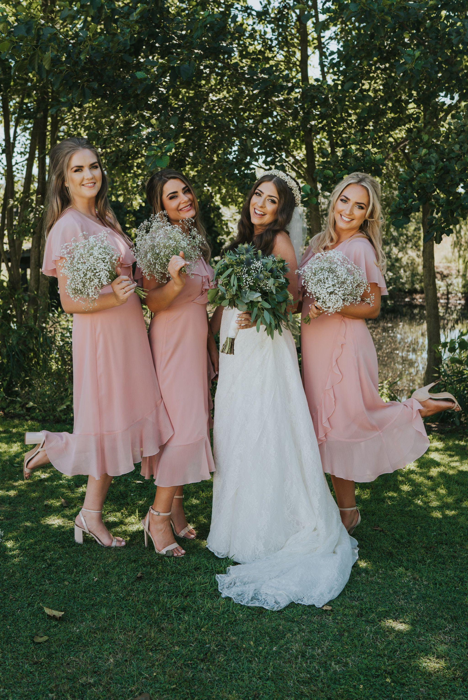 Fun portrait of bride and bridesmaid blush pink chiffon