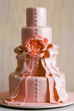 Contemporary Wedding Cake Decorated To Look Like The Brides Dress Covered With Pink