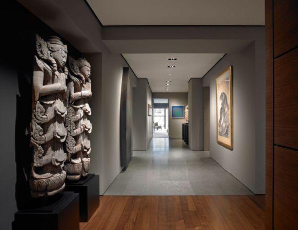 Interior gorgeous corridor with some grey statues corridor