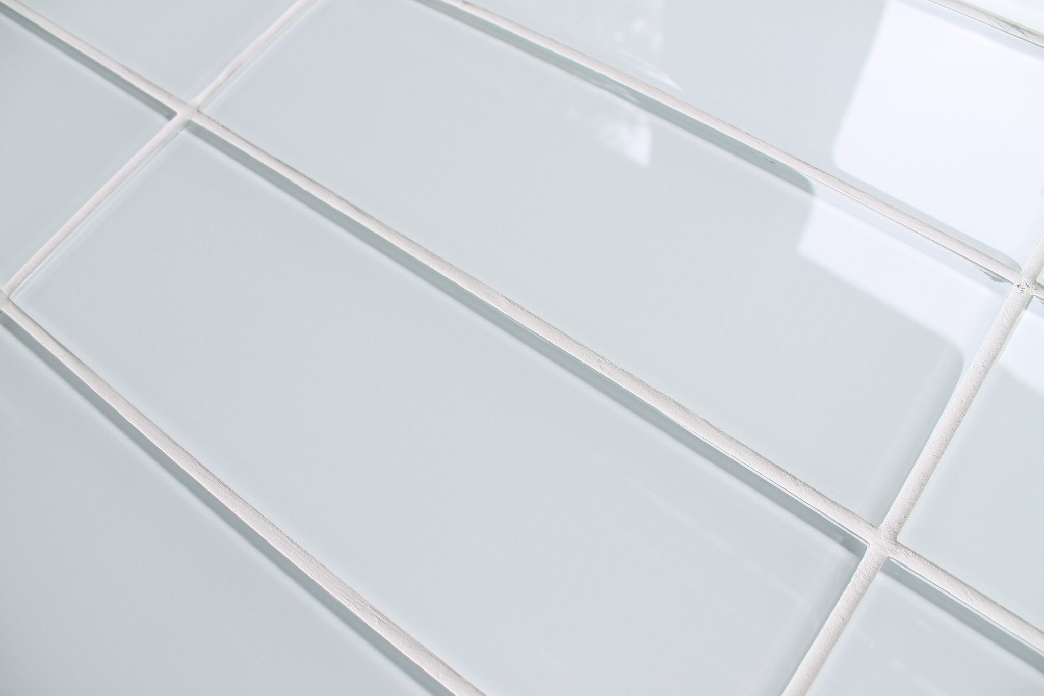 White glass subway tile this could be  more modern take on traditional ceramic tiles  think would prefer larger format like  or  also