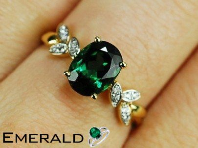 b43227c15e8 Coordinate this charming emerald ring with any ensemble from business casual  to everyday wear.