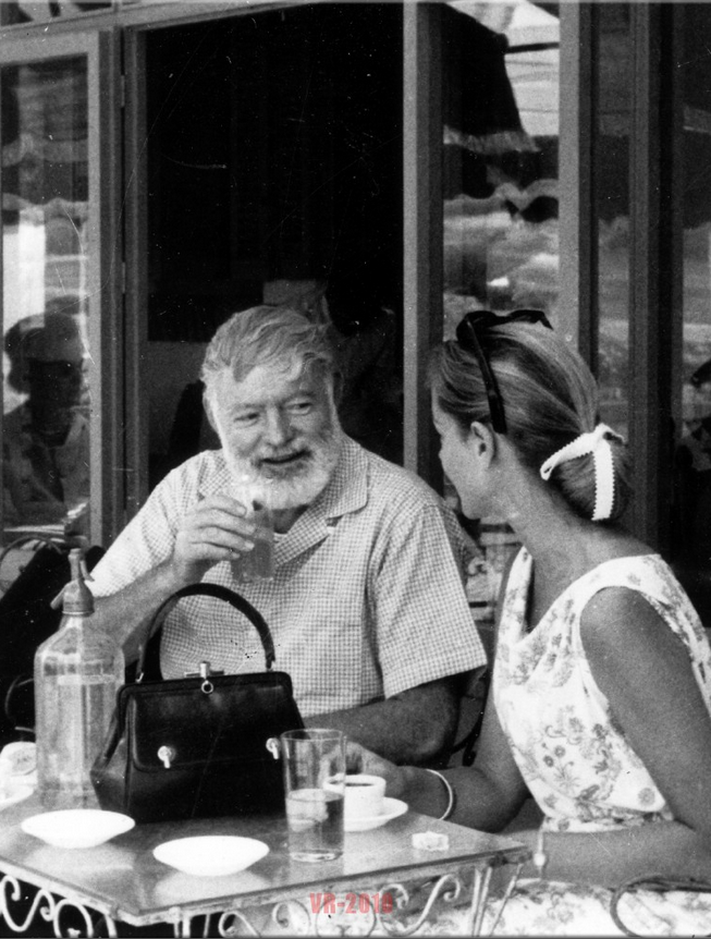 Ernest Hemingway having a drink with Lauren Bacall in Spain in the 1950's.