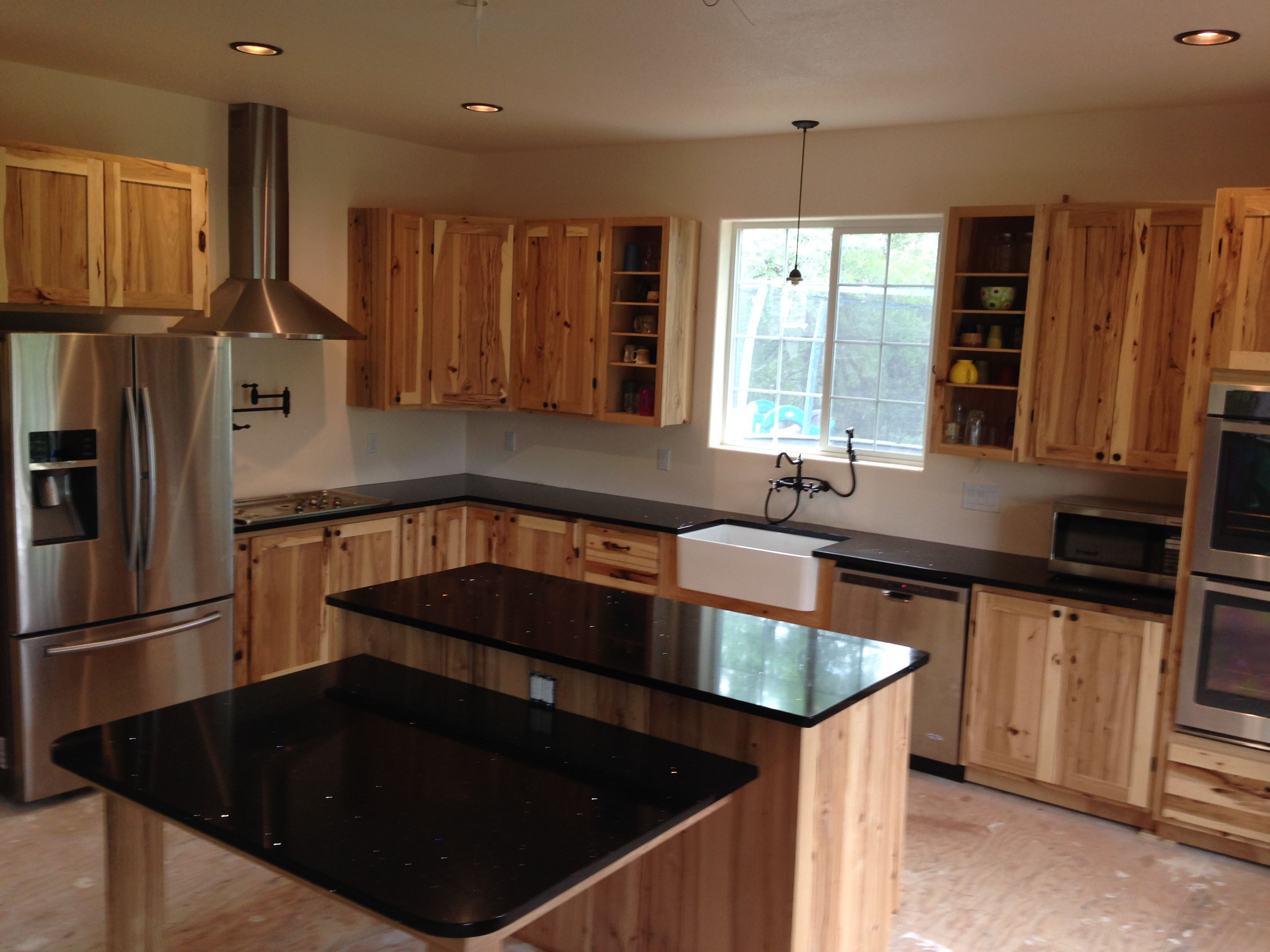 rustic black kitchen cabinets modern island with seating stainless appliances and farmhouse