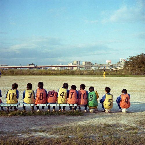 sunset caught in boys' back. by Momota.M on Flickr.
