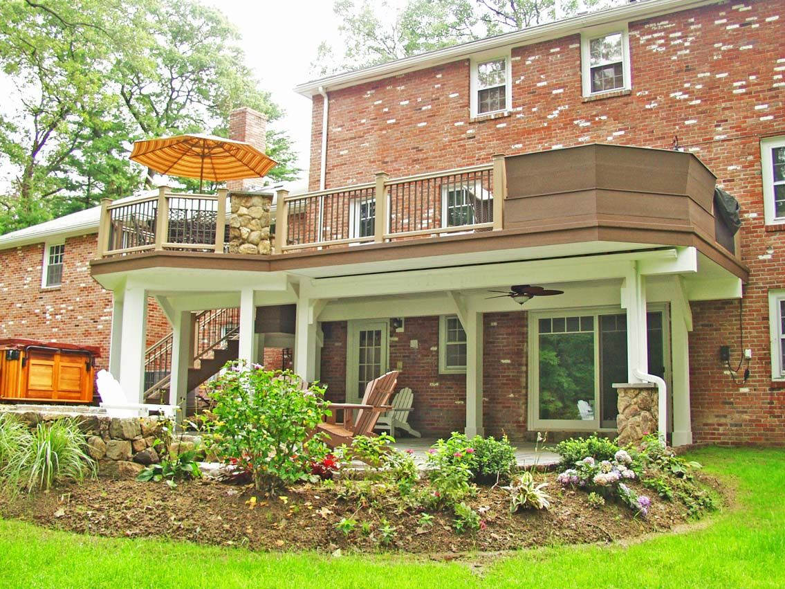 colonial home design with two story elevated deck plans sonoma colonial home design with two story elevated deck plans sonoma striped patio umbrellas and