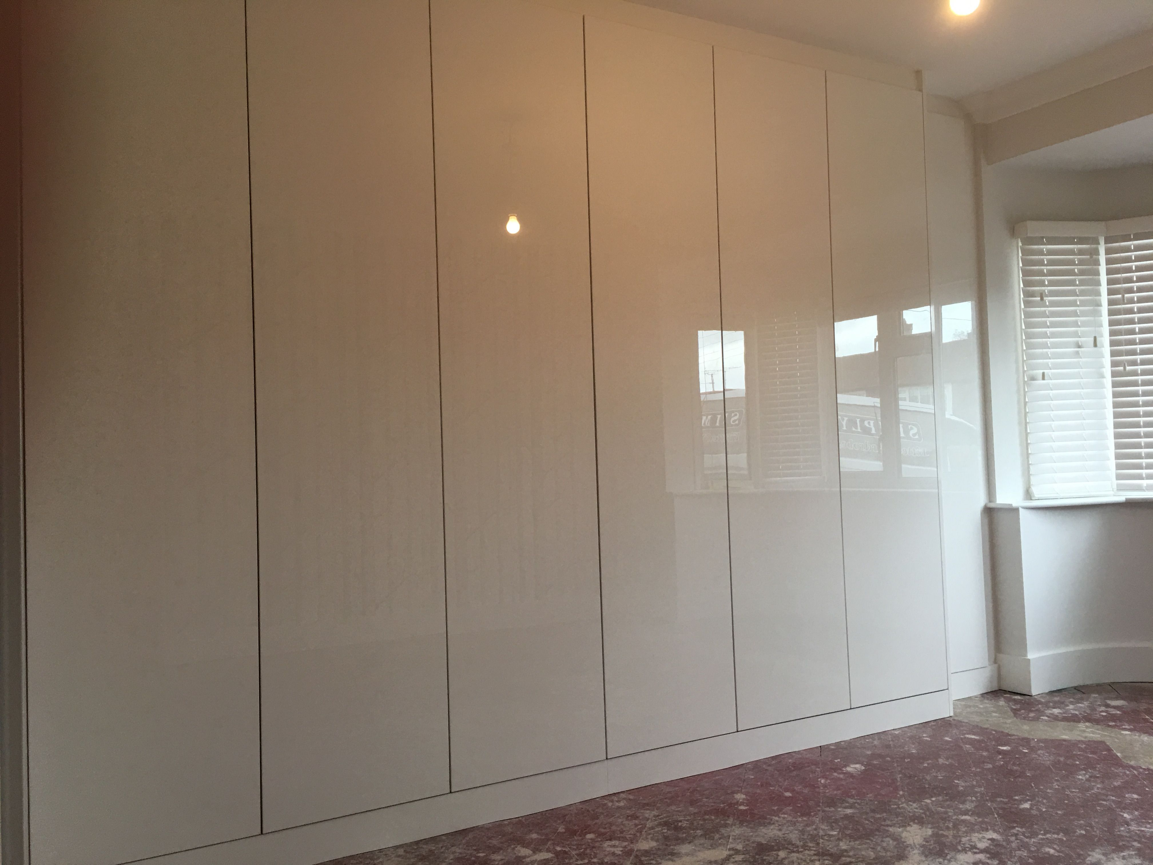 High Gloss Push To Open Fitted Wardrobes In Essex Fitted Wardrobes Closet Designs Wardrobe Doors