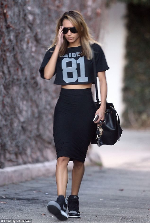 Naya Rivera steps out in Oakland Raiders top and tight