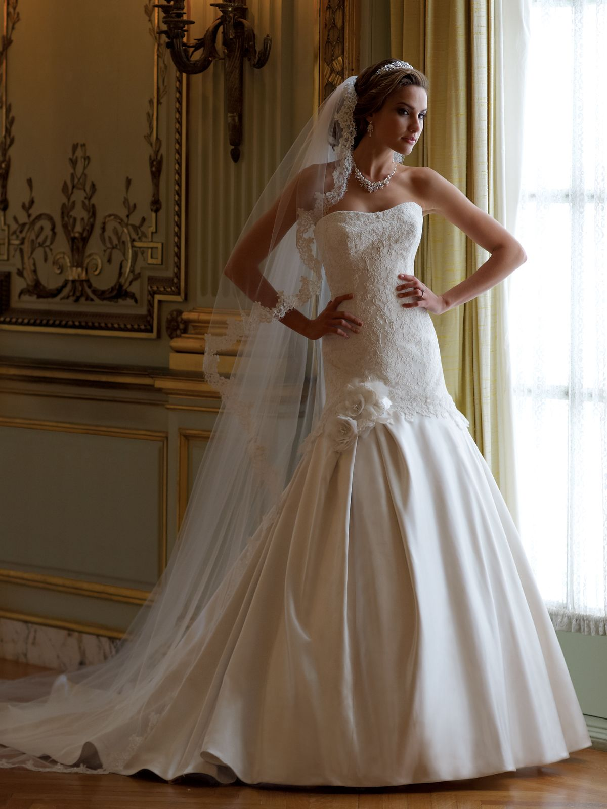 Strapless luxurious satin and lace aline wedding dress with softly