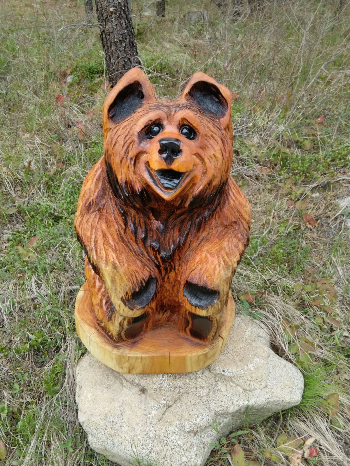 Bear carving chainsaw sculpture cub holding