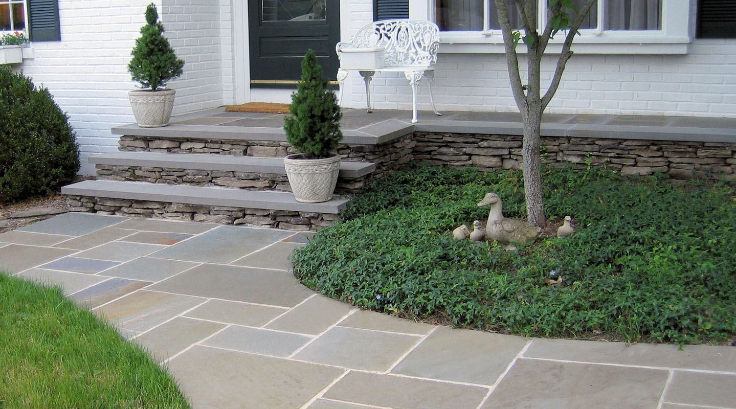 Bluestone front walk leads to stone slab steps and front for Bluestone porch