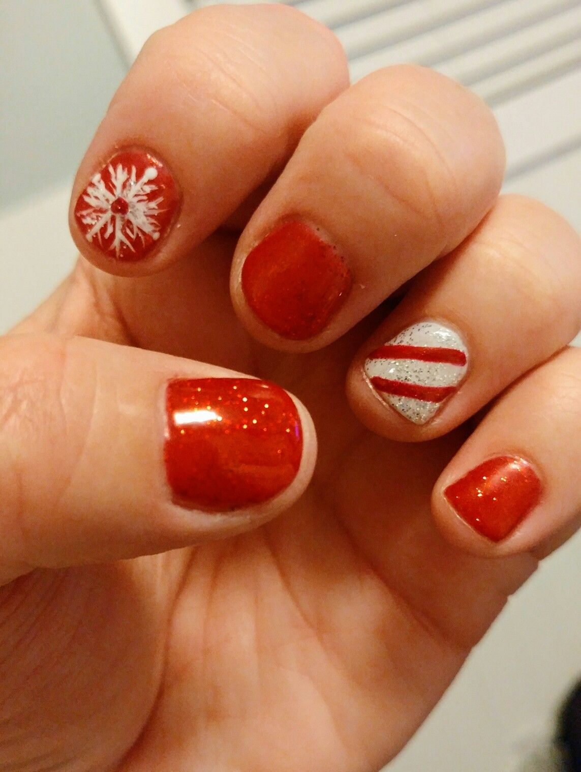 Wanted fun holiday nails #red #white #snowflakes #candycane #nailart #shellacnails