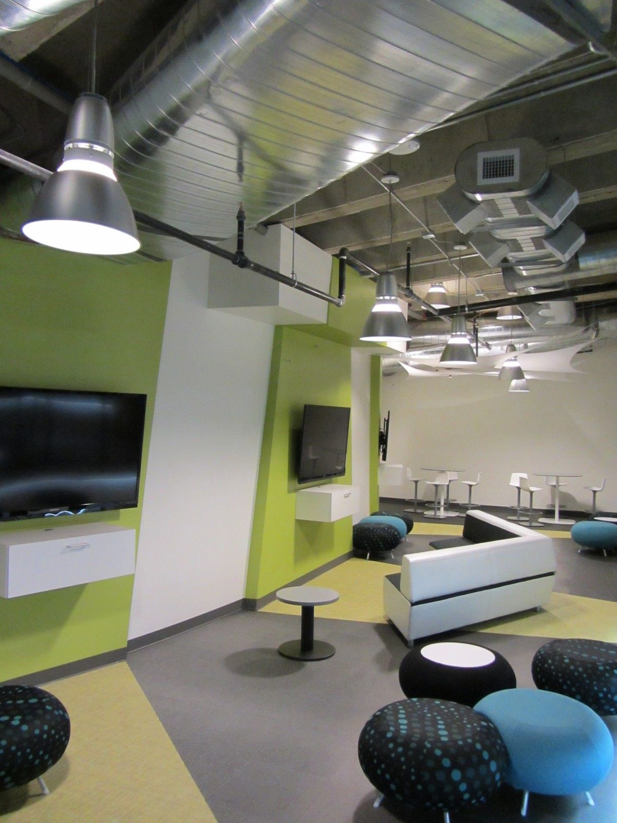 Renovation to a student union lounge included designing the right HVAC system to keep students and electronics cool without intruding on the open-concept design.